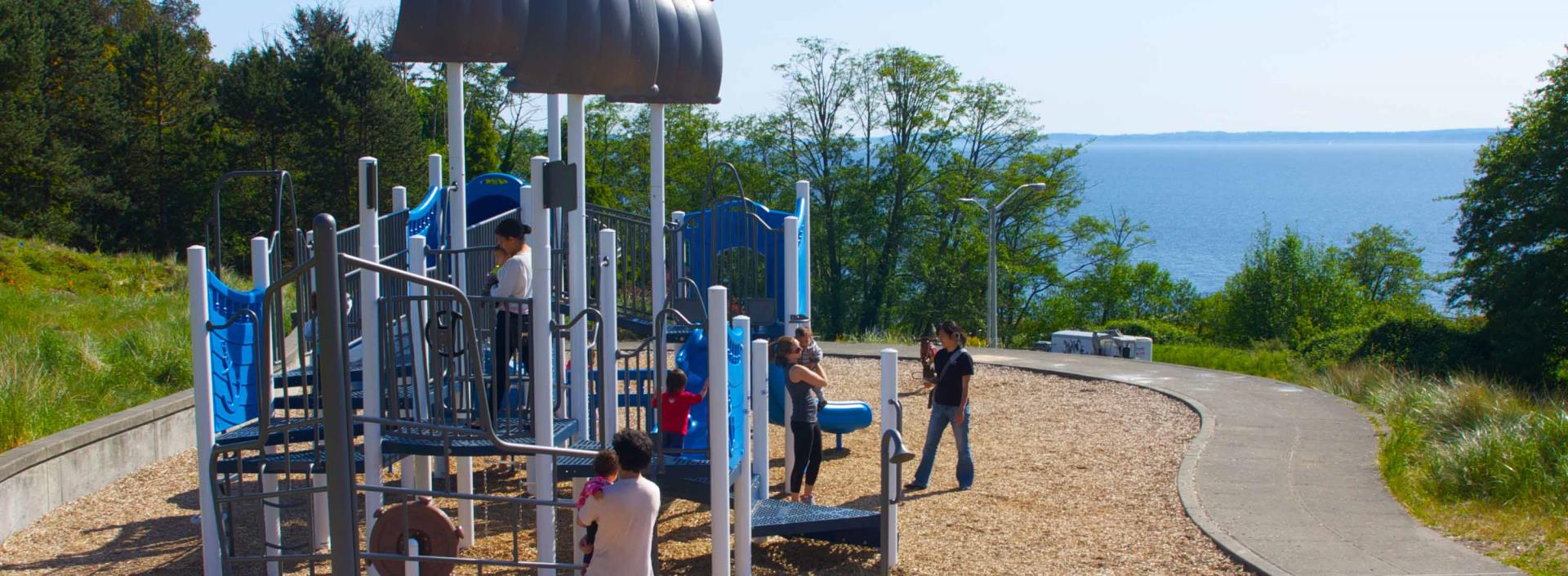 Kids and parents playing on playground at Richmond Beach Saltwater Park.