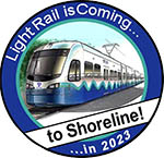 "Circular button that has a light rail train and says ""Light Rail is coming to Shoreline in 2023"""