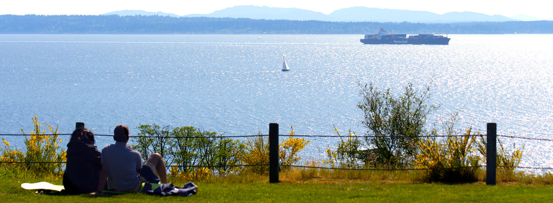 Two people looking over Puget Sound on bluff at Richmond Beach Saltwater Park