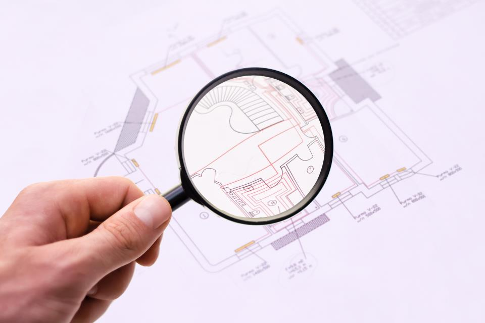 plans and magnifying glass shutterstock_124462732