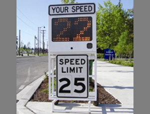 A photo of a speed cart showing 25 mph speed limit with the actual speed of a car at 22 mph.